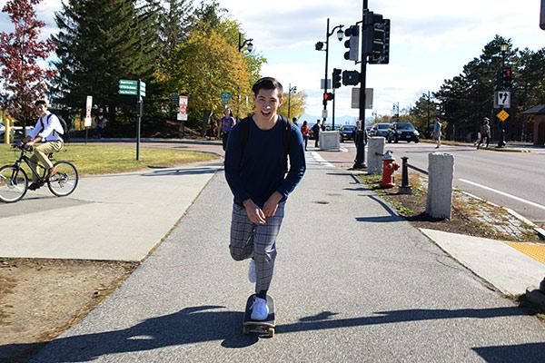 Skateboarding student