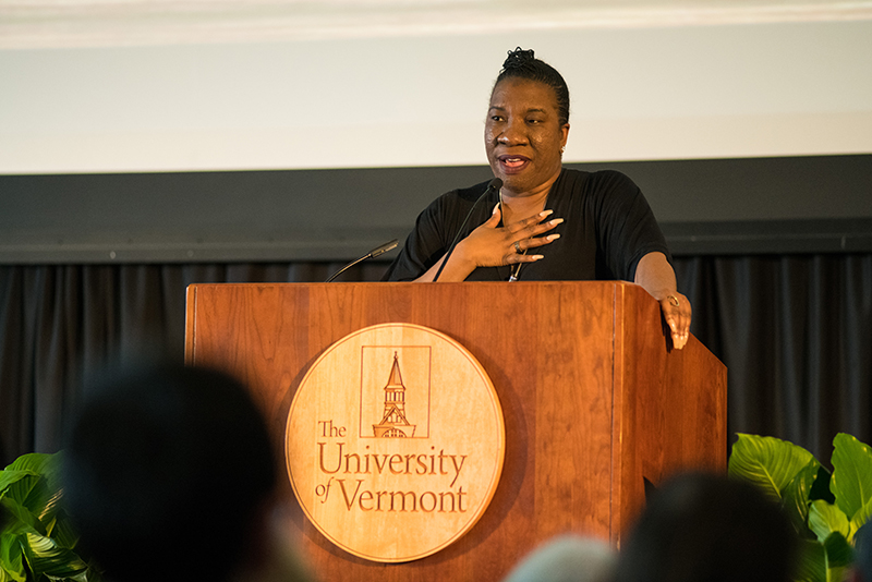 Tarana Burke speaks at podium at University of Vermont