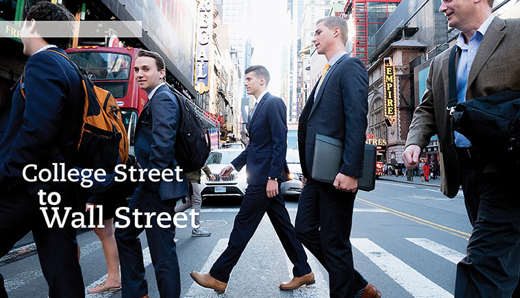 Business students crossing street in Wall St district